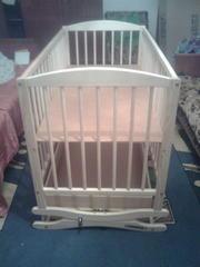 новую детскую  деревянную кроватку