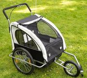 Детская коляска-прицеп к велосипеду
